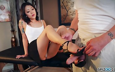 Nude Korean Saya Freshen gives a footjob and blowjob to clothed spoken for man
