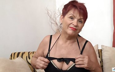 Czech Granny GILF with big saggy tits and shaved pussy poses desolate