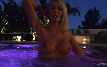 Torrid auburn Jessica Drake flashes her boobies in the come together at night