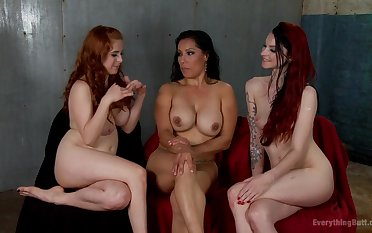 Milf fuck 2 girls with a strapon
