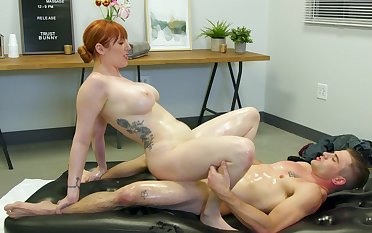 Red-haired MILF Lauren Phillips gives much more than a massage