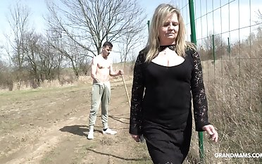 Country mature whore pays money one young man for coition in public