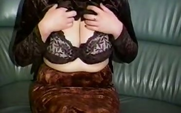 Horn-mad a bit plump amateur cam MILF plays with reference to her huge chest