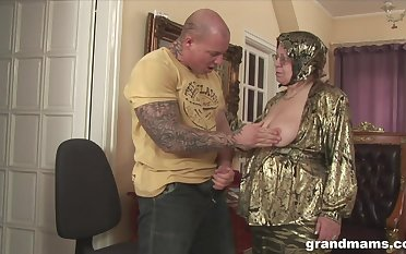 Rich granny is fucked and jizzed by hulking tattooed jock