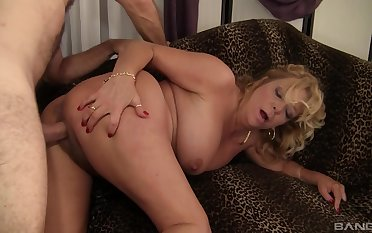 Hot mature gets stimulated apart from a man's huge dong