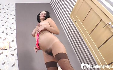 MILF strips off everything but will not hear of stockings plus high heels to the fore masturbating.