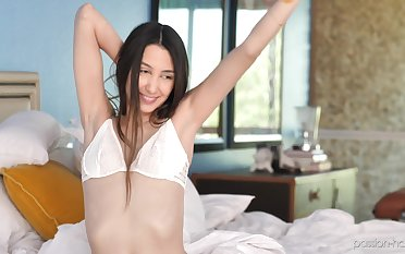 Skinny girl Natalia Nix moans loudly while bouncing on a big cock