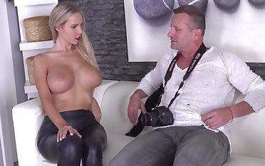 Blonde spreads counterfoil photo handbag